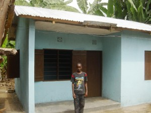 Samweli Urasa and the new house.